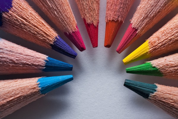 Macro of sharpened colored pencils arranged in a circle