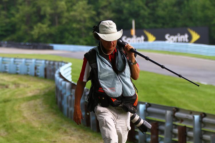 Photographer Lugging Gear Around
